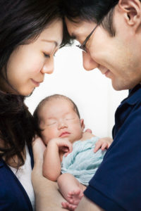 A10-day old Japanese newborn baby girl and parents